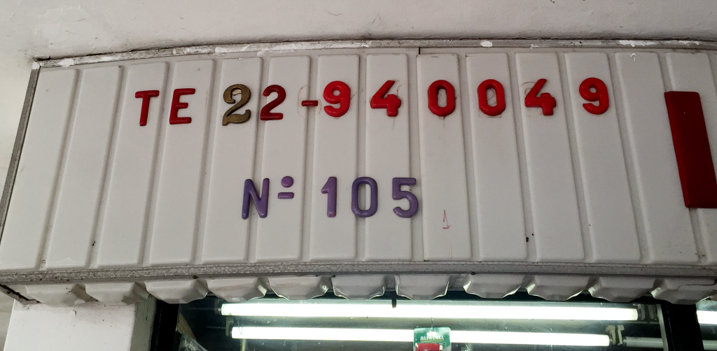 When new digits were added to landlines, some shops improvised to add the extra digit, such as this 2 taken from a door number.