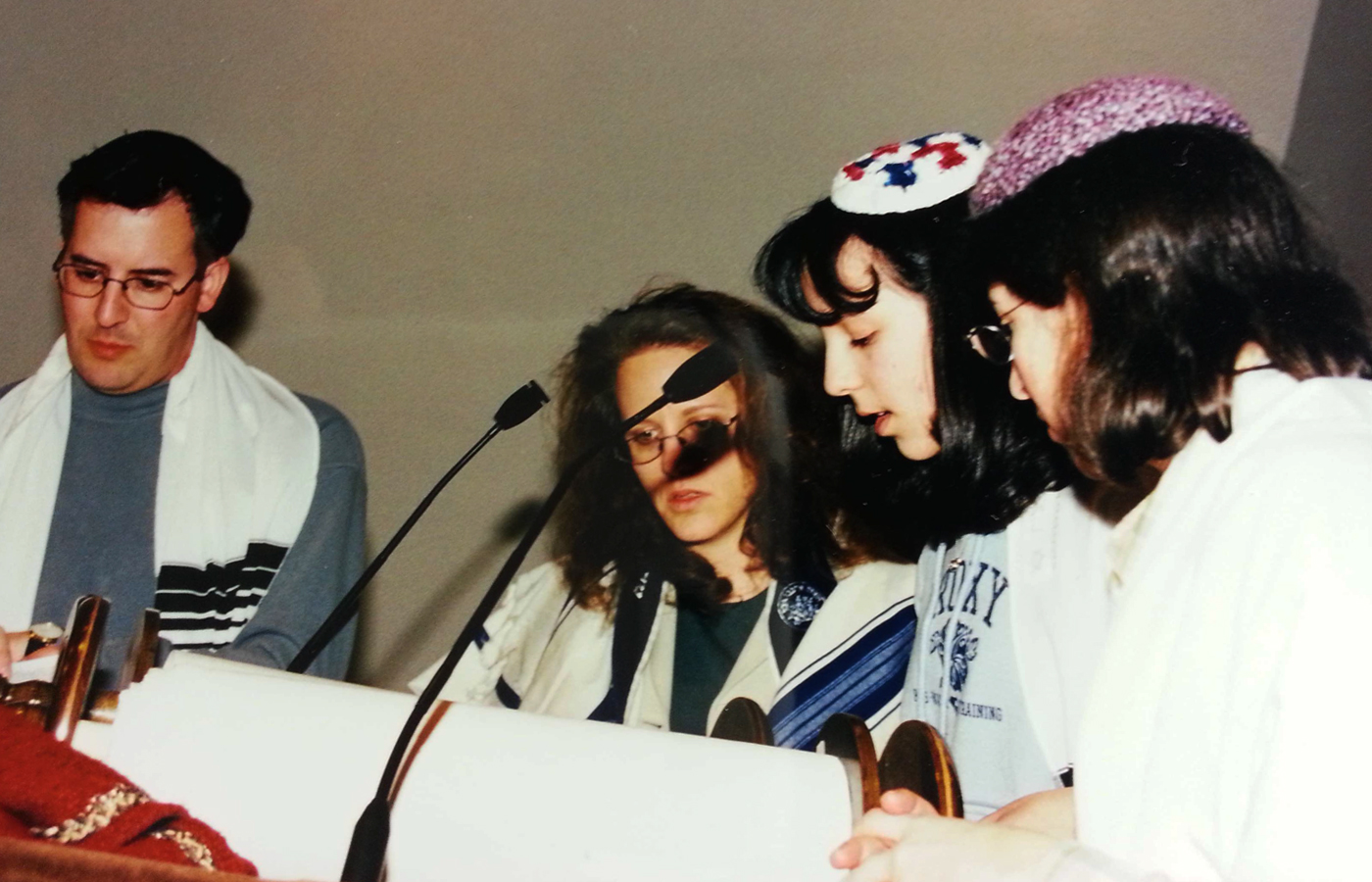 Me reading my Haftorah portion during a Bat-Mitzvah rehearsal with my aunt, uncle and cantor looking on.