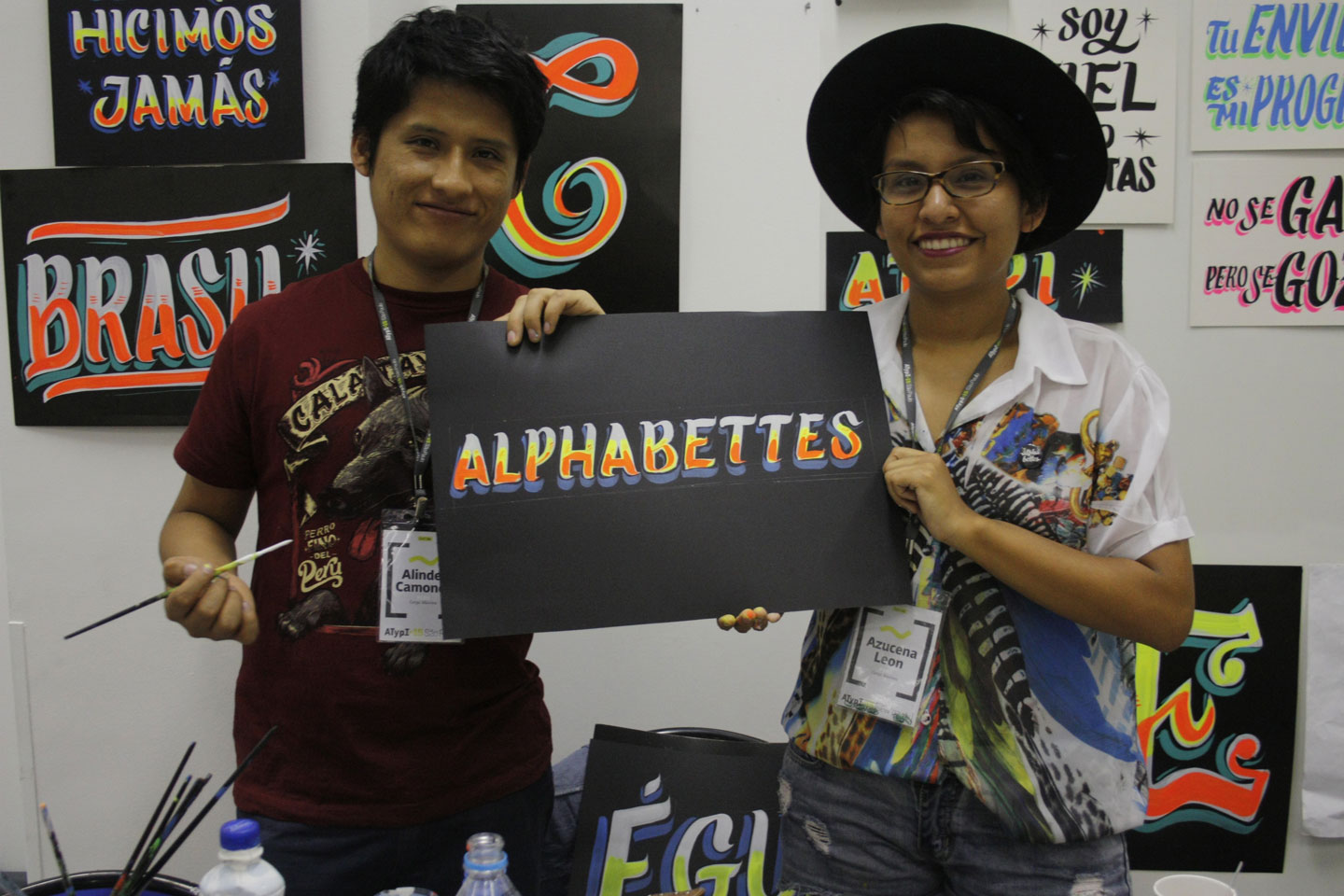 Alinder and Azucena holding the Alphabettes header