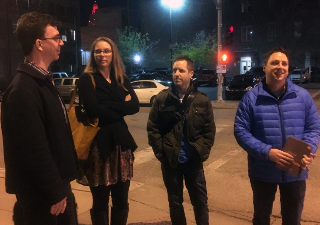 Type designers standing on a street corner at night in Kansas City