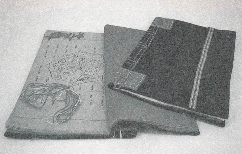 Photograph of two Third Day Book examples, one opened and one closed