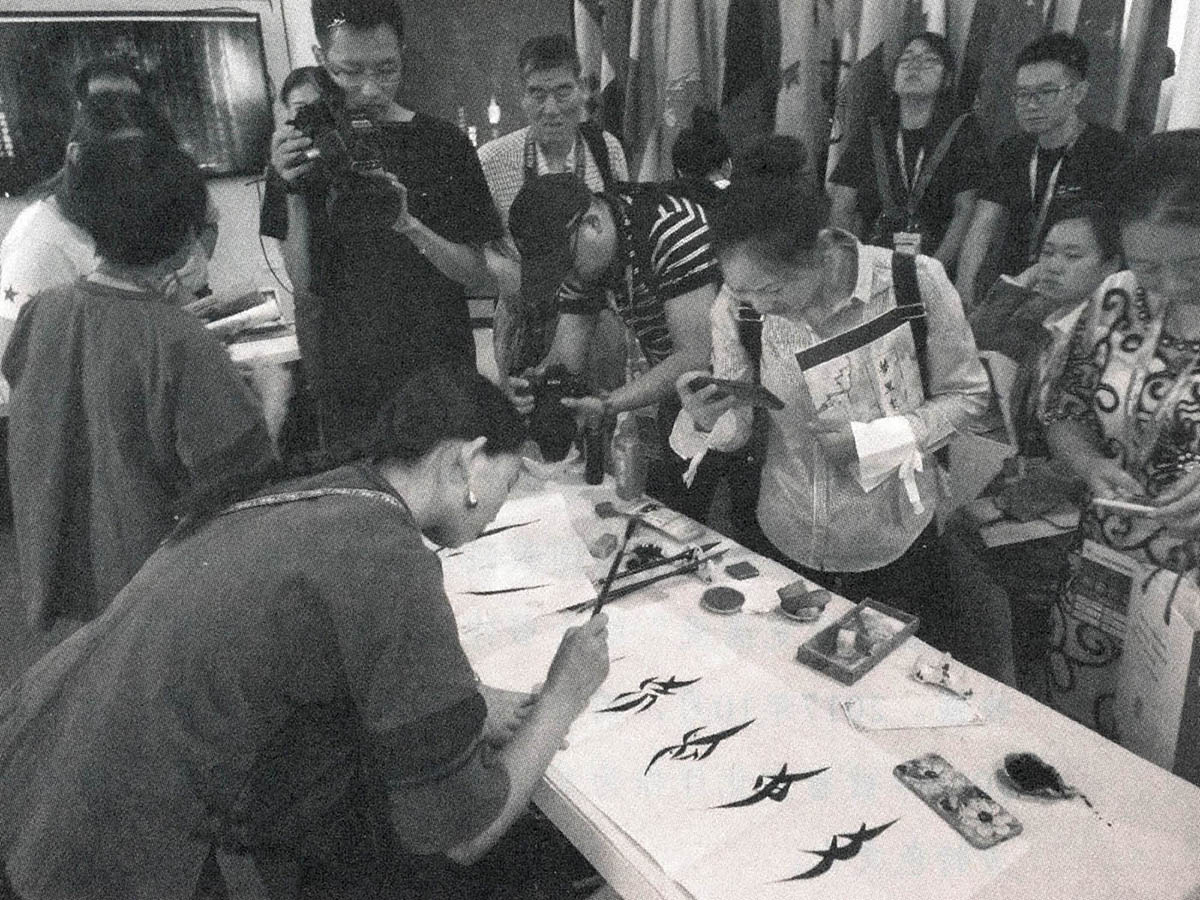 Photograph of a Nüshu calligraphy demonstration