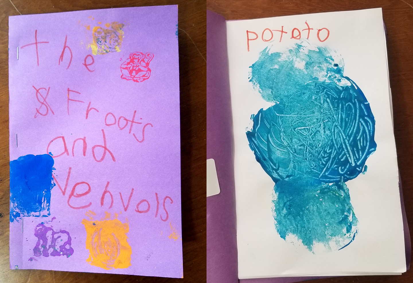 cover page handwritten by a child; interior page is filled with blue paint